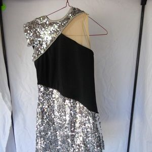 Black dress with sequin skirt and shoulders